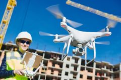 Drone operated by construction female worker on building site Stock Photography