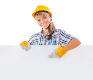 Construction female worker with white plackard Royalty Free Stock Photo