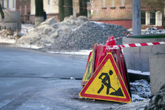 Construction fence on the street traffic. Road repair. Stock Image