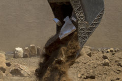 Construction fill and debris stream from fork lift shovel Stock Image
