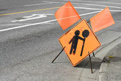 Construction flagger ahead sign. On a street stock photography