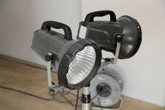 Construction floodlights to illuminate the work space.  stock photos