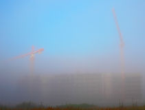 Construction in the fog Stock Images