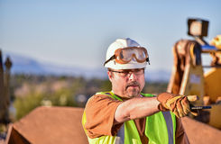Construction Foreman Directing Activities. Foreman directing activities on his left during a site visit Stock Photos