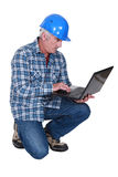 Construction foreman embracing technology Stock Photo