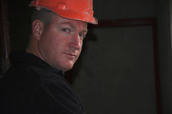 Construction foreman portrait. Construction worker foreman in house building with hard hat stock photo