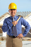 Construction Foreman Smiling. Portrait of Hispanic construction foreman on job site royalty free stock image