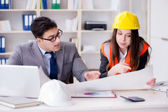 The construction foreman supervisor reviewing drawings. Construction foreman supervisor reviewing drawings royalty free stock photos