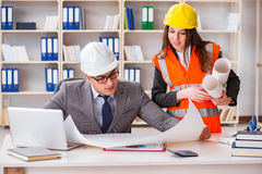 The construction foreman supervisor reviewing drawings. Construction foreman supervisor reviewing drawings stock photos