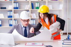 The construction foreman supervisor reviewing drawings. Construction foreman supervisor reviewing drawings stock images