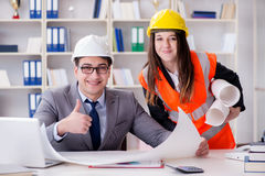 The construction foreman supervisor reviewing drawings Stock Photography