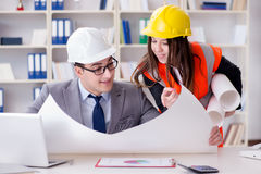 The construction foreman supervisor reviewing drawings. Construction foreman supervisor reviewing drawings royalty free stock photography