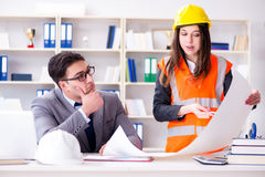 The construction foreman supervisor reviewing drawings Stock Image