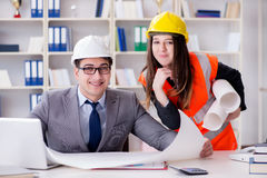 The construction foreman supervisor reviewing drawings. Construction foreman supervisor reviewing drawings royalty free stock image