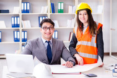 The construction foreman supervisor reviewing drawings. Construction foreman supervisor reviewing drawings stock image