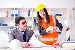The construction foreman supervisor reviewing drawings Stock Images