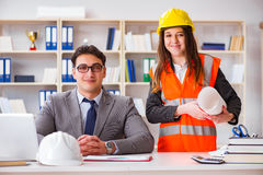 The construction foreman supervisor reviewing drawings Royalty Free Stock Photo