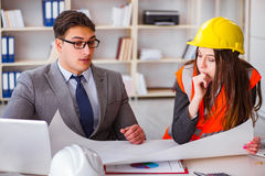 The construction foreman supervisor reviewing drawings Stock Photo