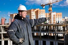 Construction Foreman Worker. A foreman gives instructions to construction workers at a building site royalty free stock photo