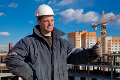 Construction Foreman Worker. A Foreman giving okay sign hand gesture at building area royalty free stock photography