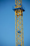 Construction in the form of a tower with ladder. Industrial construction in the form of a tower with a ladder Royalty Free Stock Photos