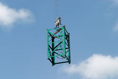 Construction frame on crane screw over blue Stock Image