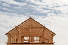 Construction of the frame house against Stock Photography