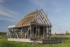 The construction of a frame house. Stromilova roof royalty free stock photography