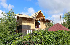 Construction of frame house. Installation of the roof during the construction frame house royalty free stock images