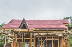 Construction of a frame house, metal roof stock images