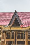 Construction of a frame house, metal roof royalty free stock image