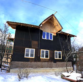 Construction of frame house. Construction of frame two-storied house in winter stock photo