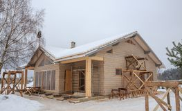 Construction of frame wooden house on the background of a pine forest, winter period Royalty Free Stock Photos
