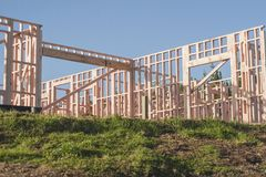 The construction of a frame wooden house. Constructing in New Zealand, Auckland, New Zealand, horizontal photo, photo is usable on picture post card, calendar stock images