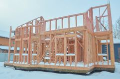 Construction of frame wooden house in winter. In winter, the construction of frame wooden house stock photos