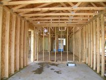 Construction - Framed Garage. Interior view of new home construction stock photography