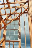 Construction Framed Window. This is a new home under construction with a window installed while its still being framed Royalty Free Stock Image