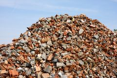 Construction garbage. Pile of bricks against blue sky Stock Photography