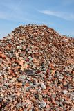 Construction garbage. Pile of bricks against blue sky Royalty Free Stock Photo