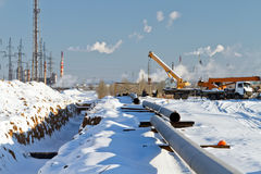 Construction of a gas pipeline in the winter Royalty Free Stock Photo