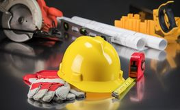 Construction Gear on Gold Tabletop with Hardhat Royalty Free Stock Photography
