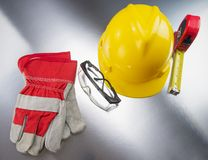 Construction Gear on Silver Tabletop with Hardhat Royalty Free Stock Image