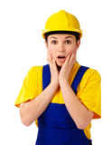 Construction girl holding her face in astonishment Royalty Free Stock Photography