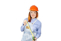 Construction girl with a tape measure Royalty Free Stock Images