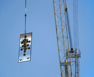 Construction Glass windows. Glass window delivery to an office building on a construction site Stock Photo