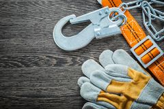 Construction gloves safety strap on vintage wooden board.  royalty free stock image