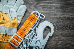 Construction gloves safety strap on wooden board Stock Photography