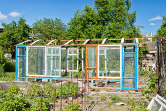 Construction of a greenhouse in the garden from scrap materials Stock Photography
