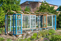 Construction of a greenhouse in the garden from scrap materials Royalty Free Stock Images