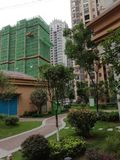 Construction and greening under construction, high-rise residential quarters, lawns royalty free stock photography